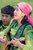 Kazakh woman playing balalaika and singing, Saty, Kazakstan