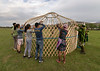 Tying down the roof poles supporting the shangyrak, yurt raising, Saty, Kazakhstan