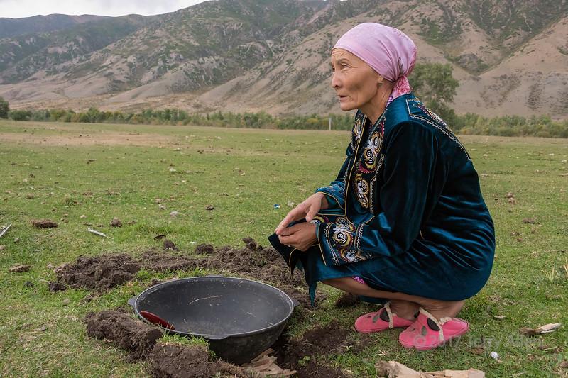 Preparilng to make baursaki (Kazakh fried dough) on on the plains, Saty, Tian Shan Mountains, Kazakhstan