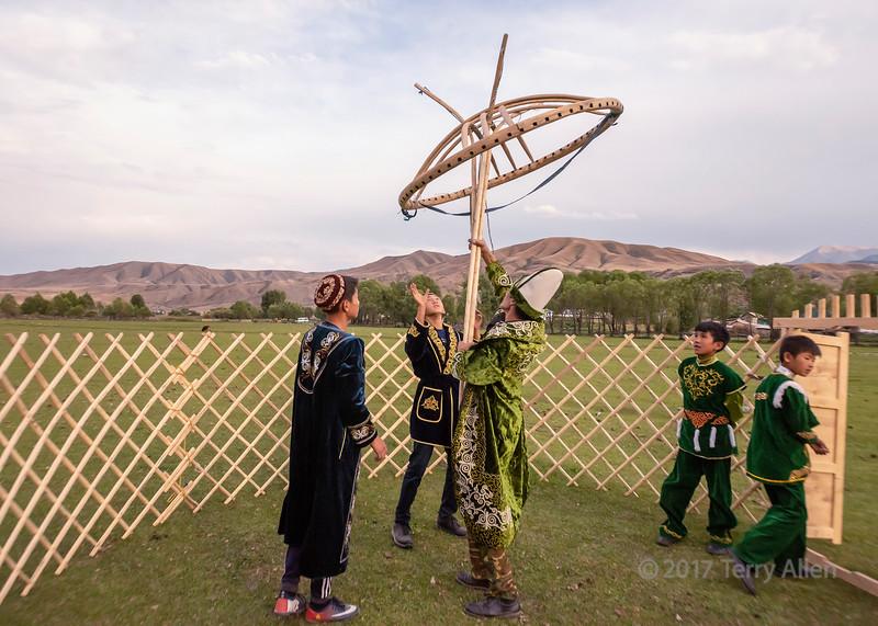 Raising the shangyrak (wooden crown) for a yurt, Saty, Tian Shan Mountains, Kazakhstan