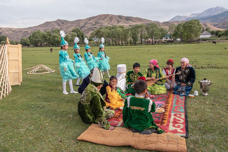 Kazakh family gathered to celebrate a yurt raising, Saty, Kazakhstan