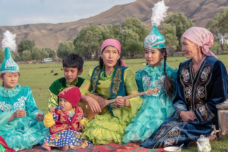 Kazakh family gathered for a yurt raising ceremony, Saty, Kazakhstan