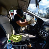 KRISTOPHER RADDER — BRATTLEBORO REFORMER<br /> Mike Coombs, technician at Shippee Auto, in Hinsdale, N.H., disinfects each vehicle before and after doing repairs on them to help prevent the spread of COVID-19 on Wednesday, April 22, 2020.