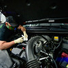 KRISTOPHER RADDER — BRATTLEBORO REFORMER<br /> Mike Coombs, technician at Shippee Auto, in Hinsdale, N.H., wears a mask and gloves to prevent the spread of COVID-19while working on a motor on Wednesday, April 22, 2020.