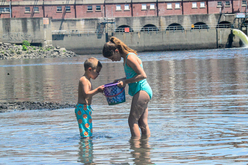 KRISTOPHER RADDER — BRATTLEBORO REFORMER<br /> Paige Jobin, 10, and Gabriel Loomis, 5, look at a tadpole at the Vernon Dam, in Vernon, Vt., on Monday, June 22, 2020.