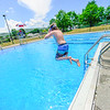 KRISTOPHER RADDER — BRATTLEBORO REFORMER<br /> Mason Floyd, 10, jumps into the Vernon Recreational Pool, in Vernon, Vt., on Monday, June 22, 2020.