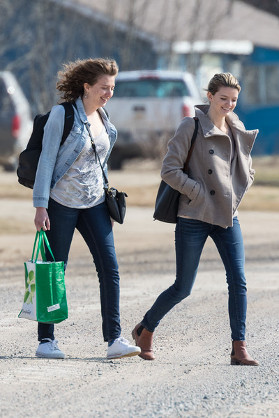 Articling student Christine Conrad and summer law student Katherine Pipe head to the docks for the trip to Moose Factory.
