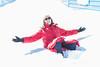 Kathy Laird sitting in the snow in Moosonee.