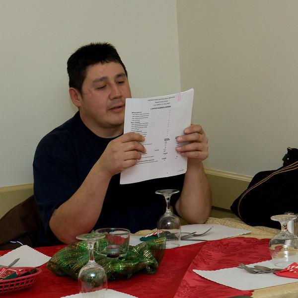 Desmond Linklater reviews meeting materials.