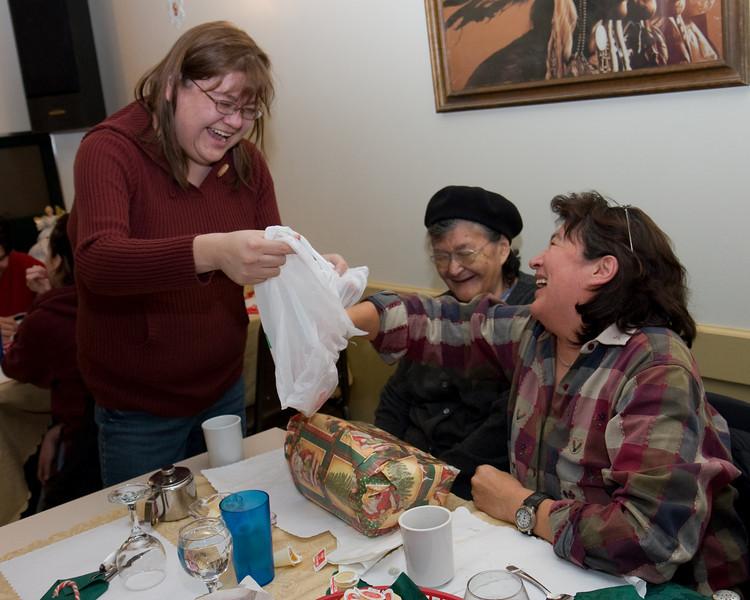 Celine Koostachin drawing the winning ticket for the second door prize