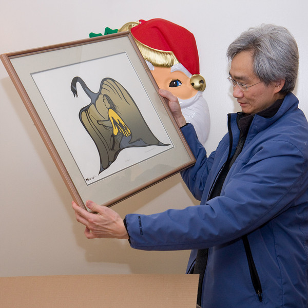 Fintan Lee with his gift, a silkscreen print by the late Richard Kamalatisit.