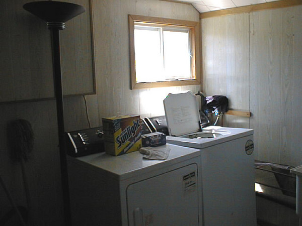 Laundry area Keewaytinok Native Legal Services staff house at 77 Bay Road in Moosonee