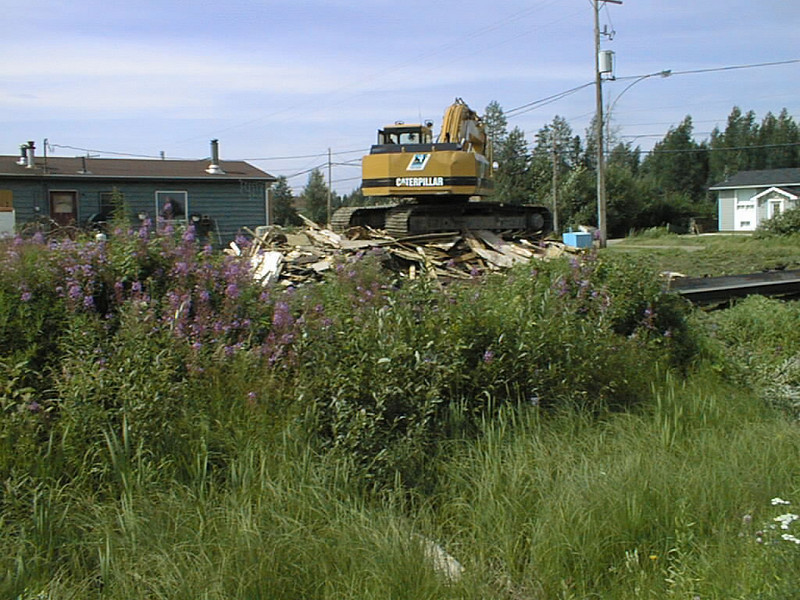 Demolition of Keewaytinok Native Legal Services staff house at 77 Bay Road 2002 August 13