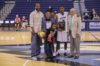 Keiser Senior Tyrus Weaver with family and Coach Massimino