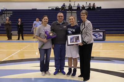 Keiser senior Kaylee Patton with parents and Coach Oswald
