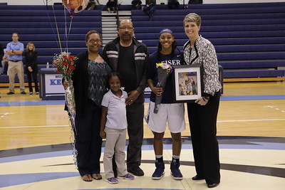 Keiser senior Miah Shephard and family with Coach Oswald