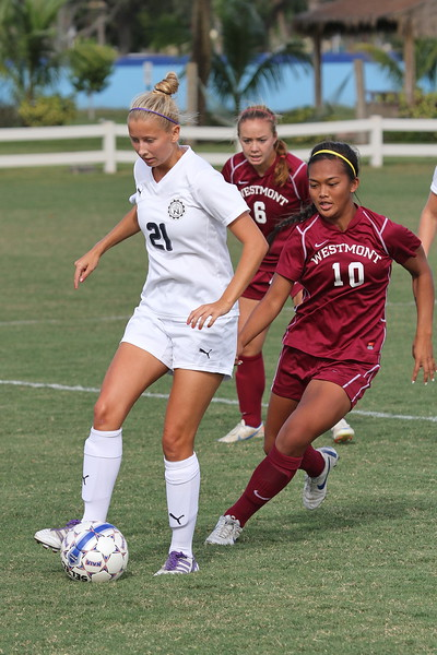 Northwood Midfielder Maria Tornqvist with the ball as Westmont's Tiffany Dimaculangan approaches