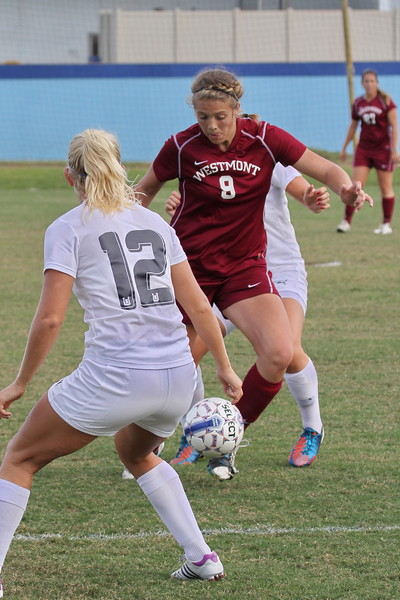 Westmont Forward Kaci Mexico advances as Northwood Midfeilder Elina Landeskog (12) closes