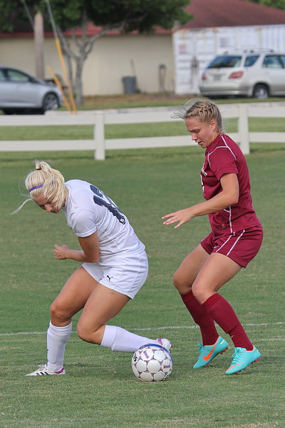 Westmont Defender Alison Hensley closes in on Northwood Midfeilder Elina Landeskog (12)