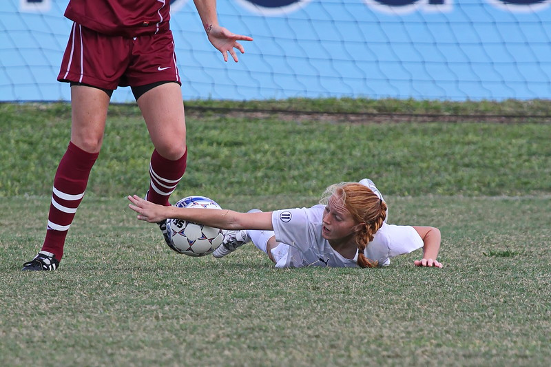 Northwood Defender Ashley Forgit (on ground)