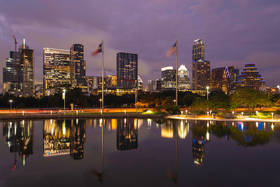 Reflections of the city skyline at dusk in Austin Texas