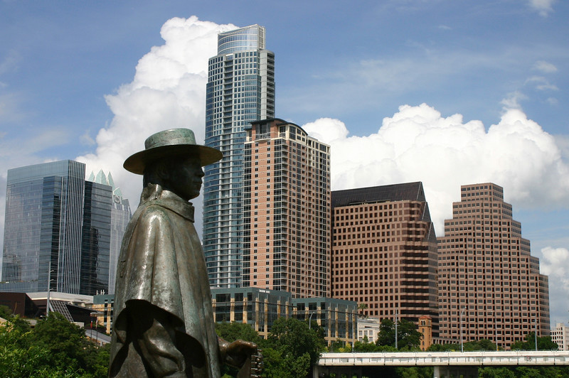 Stevie Ray Vaughn and the skyline of Austin Texas