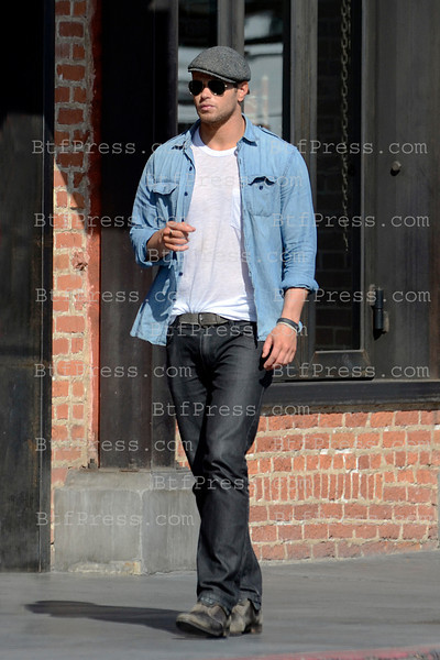 Kellan Lutz from Twilight take a walk with a friend in Venice California.