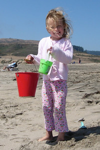 Kelly with buckets on the beach