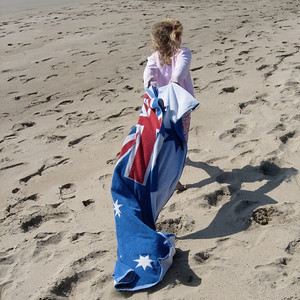 Kelly with Australian beach towel on the beach