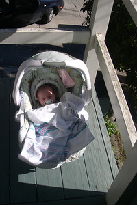 Kelly in car seat on front porch