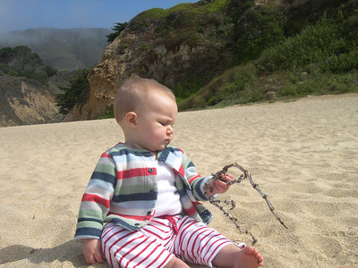 Kelly on the beach with a stick