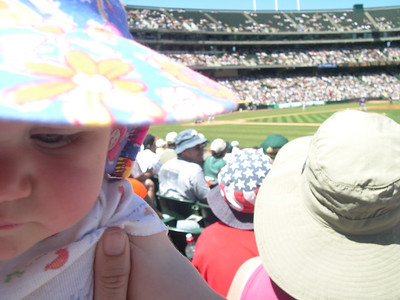 Kelly at her first As baseball game