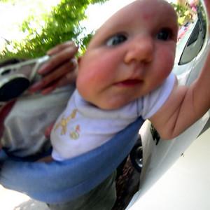 Kelly in car mirror