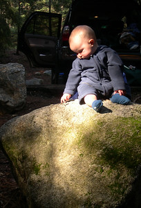 Kelly sitting on a rock at the campground