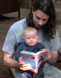 Daddy reading with Kelly