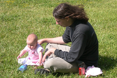 Kelly and her Daddy playing on the grass at Stevie's birthday party