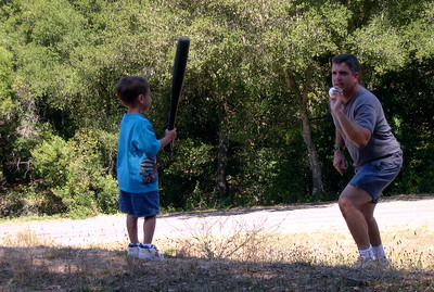 Stevie and Chris playing baseball