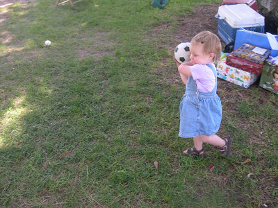 Kelly throwing a ball at Stevie's 4th birthday party