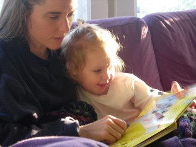 Anne reading book to Kelly