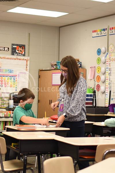 Helping a student, senior Kelsie Conard student teaches at Bergman Elementary School here in Manhattan, Kansas. Wednesday, November 12, 2020. ( Collegian Media Group)
