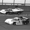 Michigan Int, #10 Andretti And #14 Al Holbert Battle The Banks, 1984