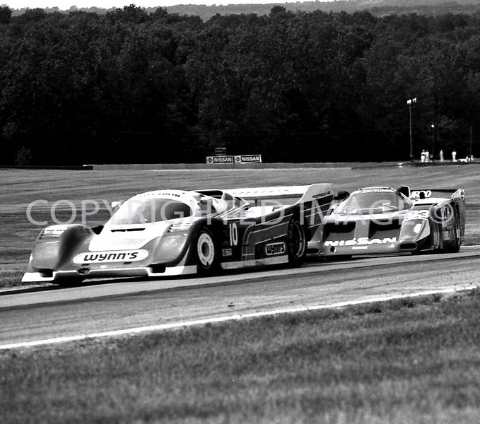 Mid Ohio, #10 Jim Adams Holding Up #83 Geoff Brabham, 1988