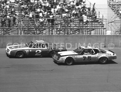 Michigan Int, #2 Dave Marcis Puts Pass On #75 Butch Hartman, NASCAR, 1977