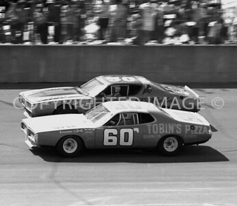 MIchigan Int, #60 Jim Tobin Dives Under #50 George Giese, USAC, 1976