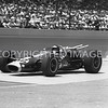 Indianapolis, Jimmy Clark leaves pits after pit stop, 1965