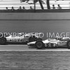Indianapolis, 1 A.J. Foyt trying to get by Al Unser 45, 1965