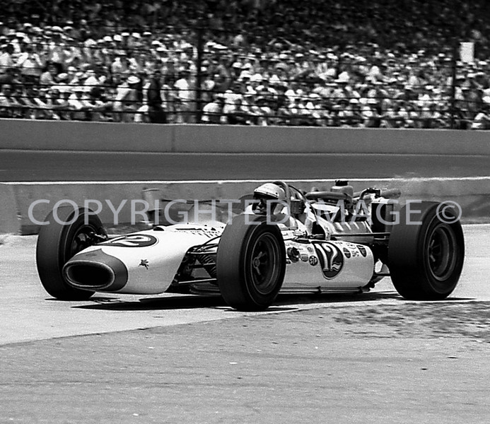 Indianapolis, Mario Andretti, Leaving pit after stop, 1965