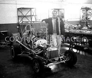 Houston, Foyts Shop, A J poses with Midget that he won with at Astrodome, 1970