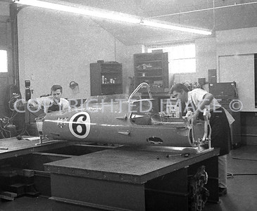 Houston, A young Jack Starne & crew member work on Foyts Indy Car, 1970