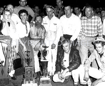 Anderson, Duman with Wife owner and Friends after win, 1960